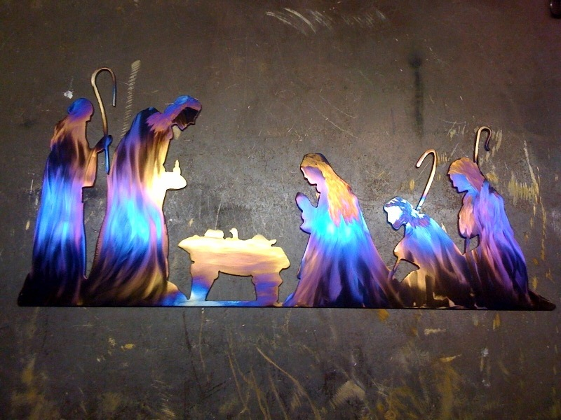 flame torched nativity scene